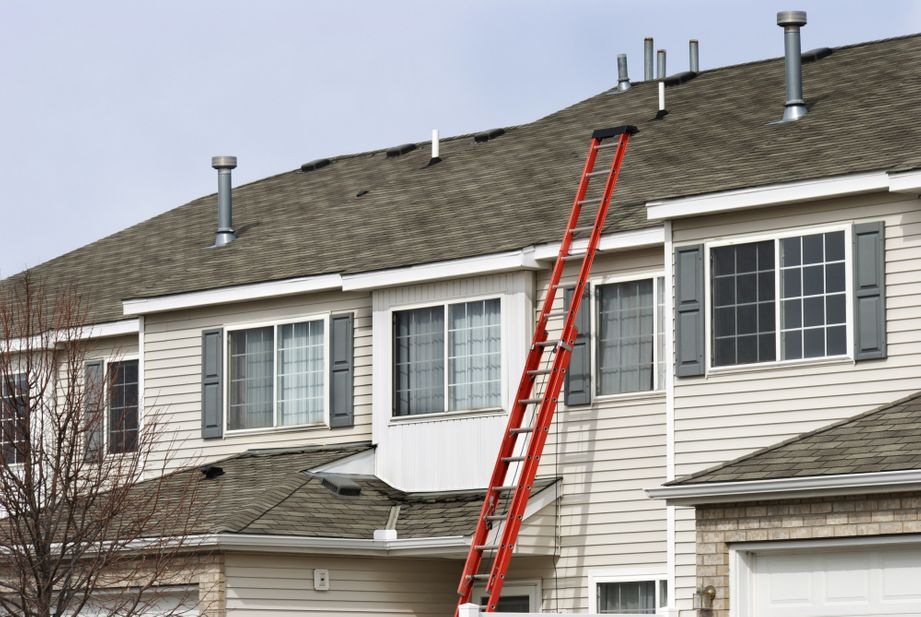 red extension ladder leaning against the house